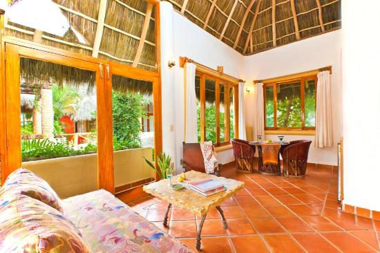 Hotel Vogue: Upper bungalows feature large windows and palapa roofs.