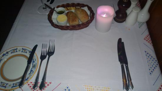 The Tavern Restaurant: Place Setting & Crisp Breadrolls