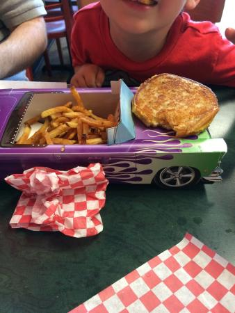 Richie's Burger Urge: They have those adorable old school cars that they bring kids food in! Helped my five year old (