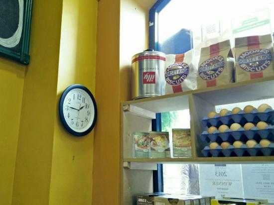 Sienna Deli: The backward clock and eclectic choice including Dorset Knob biscuits.