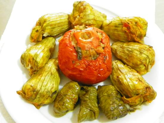 To Stachi: Zucchini flowers, wine leaves and tomatoes stuffed with rice and herbs !!!