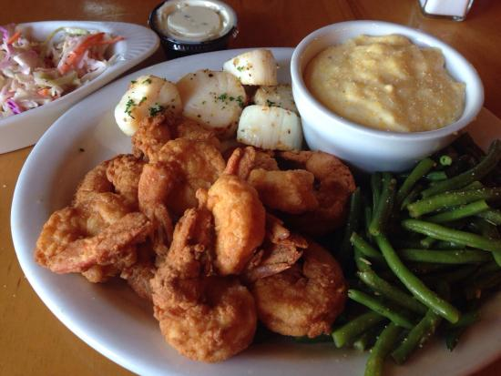 The Waterfront Restaurant: Fried shrimp was delicious. I added scallops to meal for 5.99. Tasty grits and beans. Live music