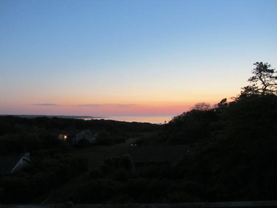 Menemsha Inn and Cottages: Sunset from the room's deck.