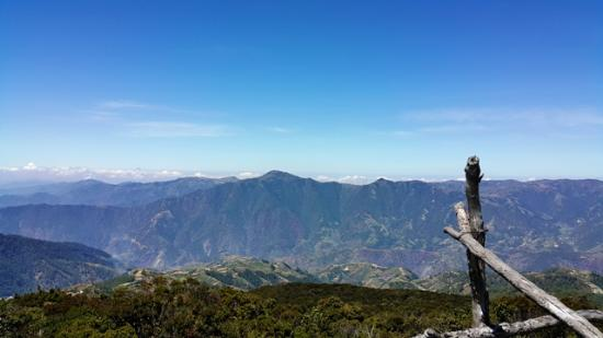 Benguet Province, Philippines: View of Benguet from the summit. Mt. Timbak can be seen with its pointed brown top