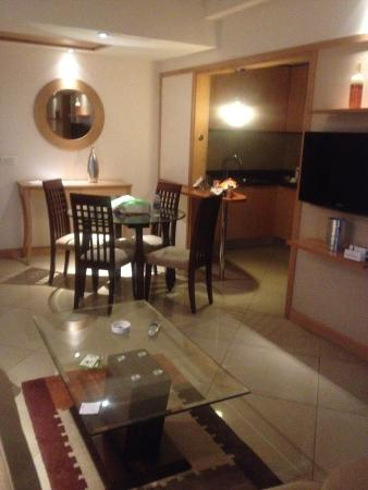 Savoy Suites Manesar: living room and kitchen