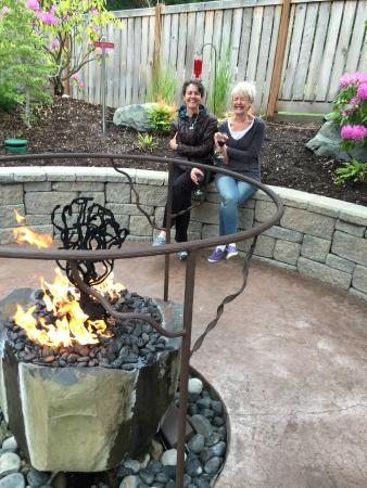Visitors to Zog's on Fox Island enjoy one of two outdoor firepit seating areas.