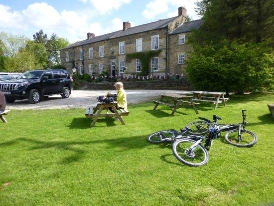 White Horse Farm Inn : sitting in the sun at the front of the hotel enjoying a pint