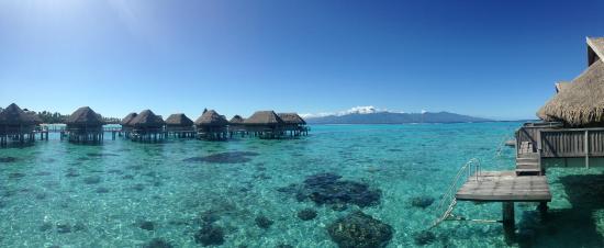 Sofitel Moorea Ia Ora Beach Resort: Daytime view of bungalows & Tahiti from #106