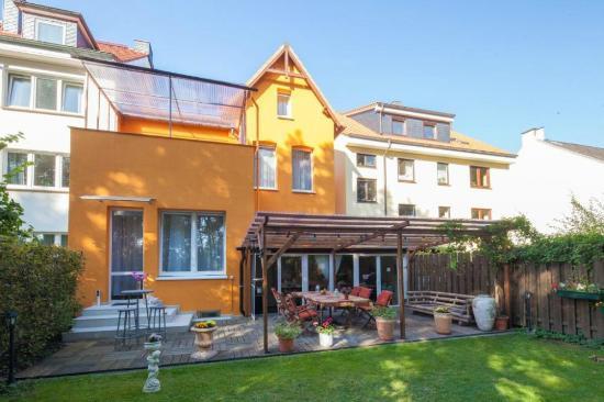 signature hotel marco polo rckseite mit dem frhstcks wintergarten