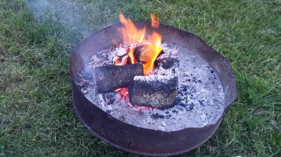 Priory Mill Farm Campsite: A fire pit for warmth and cooking