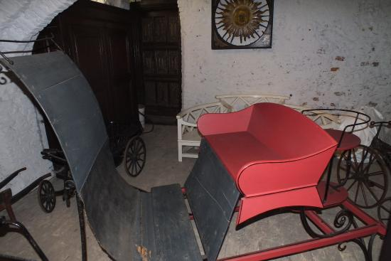 Strangers' Hall Museum: An old carriage in the undercroft