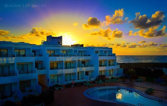 Apartamentos Galeon Playa: sunrise over Galeon Playa, view on a back swimming pool. photo: Adam Tas  #lanzarote #adamtas