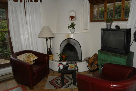 Dunshee's Casita: Sitting area and fireplace in bedroom