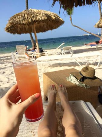 Be Live Collection Punta Cana A Nice Drink On The Beach Under Palm Umbrella
