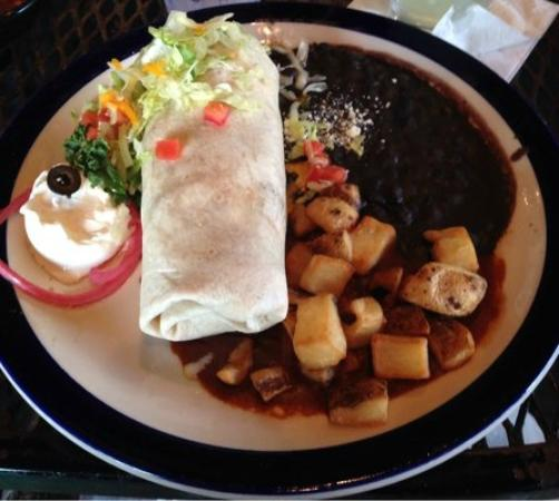 Iguana Mia: Chicken burrito (flavorless), black beans (from a can) & fried potatoes (frozen from a bag).