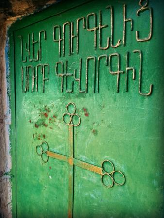 Beautiful green door at Saint Gevorg Church in Geghashen, Armenia