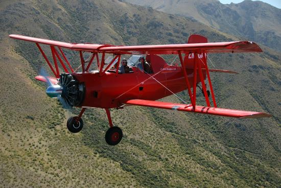 Twizel, New Zealand: Red Cat Biplane Flights Grumman Ag-Cat aircraft.