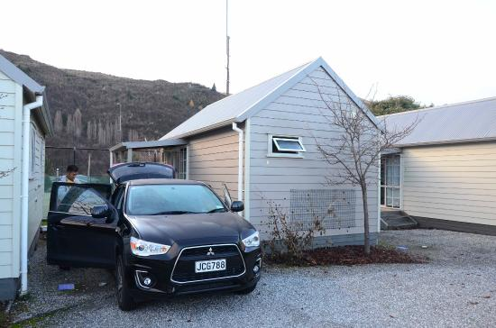 Arrowtown Holiday Park: The cabin which consists of one room with a kitchenette, a queen size bed and bunk beds.