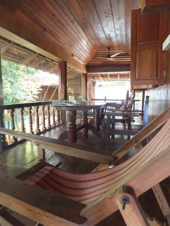 Malayalam Lake Resort Homestay: Balcony with chairs designed for reading, sleeping and viewing