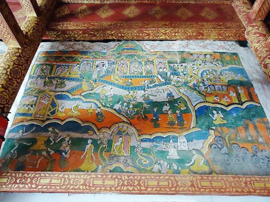 """Manzailong Mural: 曼宰竜缅寺,亦称""""中缅寺"""",与勐遮镇政府同在一街道""""国防路(至西定章郎公路)上,邻曼吕佛寺。壁画据传绘于傣历1230年(公元1868年),由七幅色彩艳丽的佛经故事组成,傣家民间艺风鲜明,州级文"""
