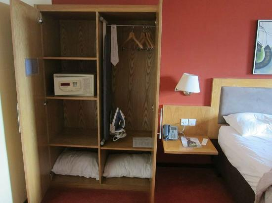 Hennessy Park Hotel : The wardrobe with safe, iron, ironing board and spare pillows
