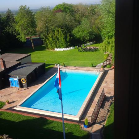 De Rougemont Manor: The view of the pool from my bedroom