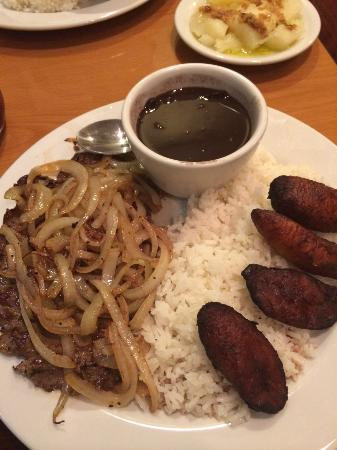 Sabor de Cuba: Grilled think steak with onions, beans, rice and plantains