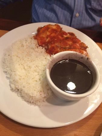 Sabor de Cuba: Chicken breaded dish with cheese, beans and rice