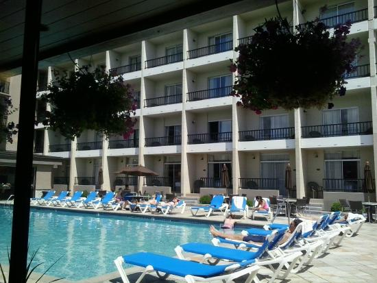 Coast Capri Hotel Kelowna The Pool Area Is Great For Sitting With A Drink Or