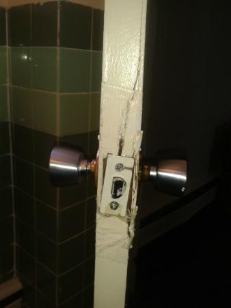 The Olympia Motel: Yes the bathroom door, note the fix?  Duct tape and a repaint of the door over duct tape