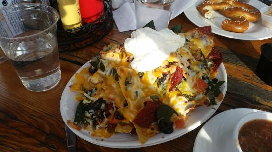 Old Schoolhouse Brewery : The Nachos, along with a pretzel in the background.