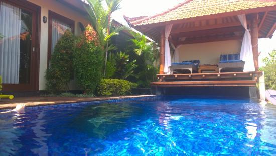 Infinity pool looking towards cabana and room