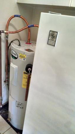 Kai Aloha Apartment Hotel: Hot water heater and refrigerator in kitchen