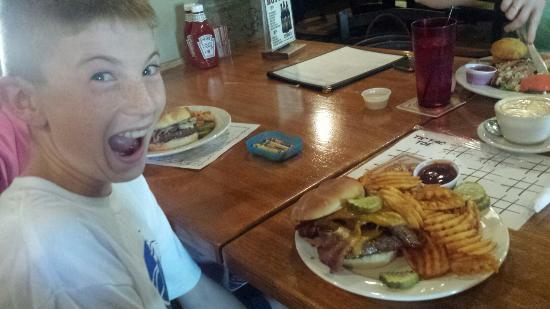 Grumpy Troll Pub & Brewery: My son Joe is pumped to eat his grumpy burger!