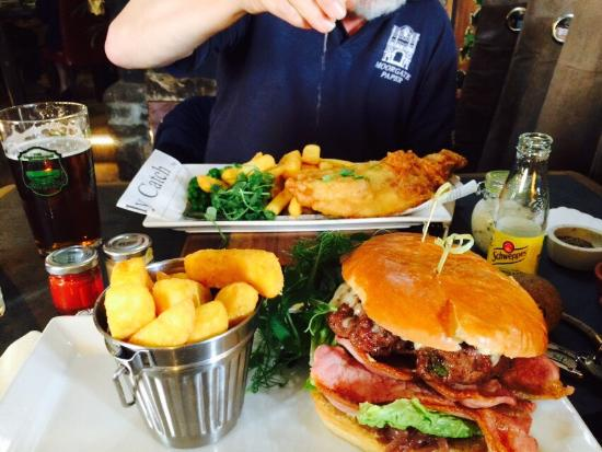 Coach and Horses: Fillet burger with cheese, bacon and truffle mustard and tempura hake with peas and homemade tar