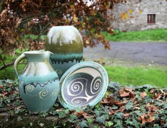 Cratloe, Ireland: green range of stoneware pottery on our front wall
