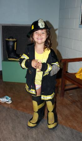 Greensboro Children's Museum: In the fireman garb ready to climb on the truck