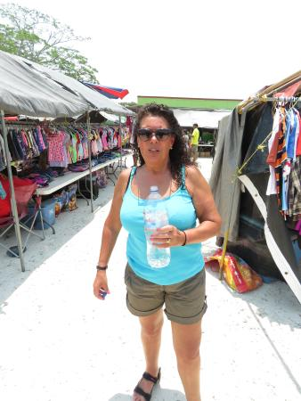 San Ignacio Market : My wife Jacqui taking in some water whilst walking the market area