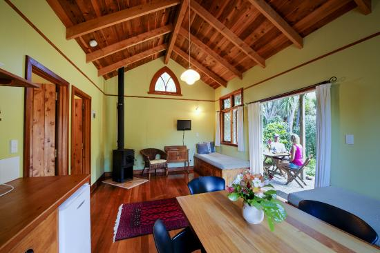 The Church Accommodation: Open-plan living opens onto sunny private deck in our Self-Contained Cottages