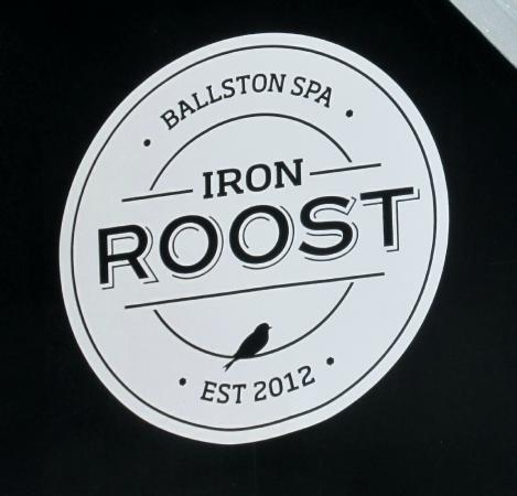 Iron Roost logo on canopy overhanging restaurant