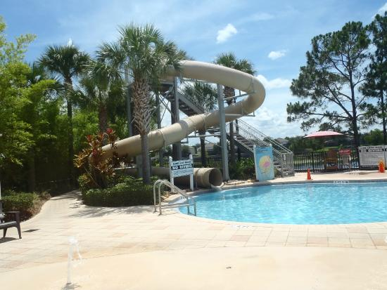 Community water slide at pool picture of windsor hills executive plus resort four for Windsor swimming pool with slides