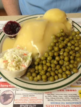 Kawkawlin, MI: turkey lunch plate -turkey, mashed potatoes, dressing, gravy, cranberry, coleslaw, peas , biscui