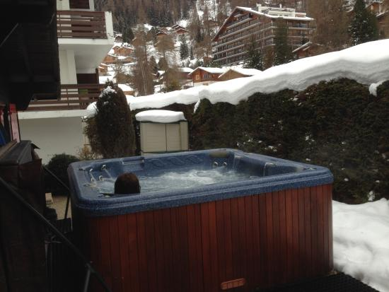 Chalet Christy : Hot tub out back. Great after a day of skiing.