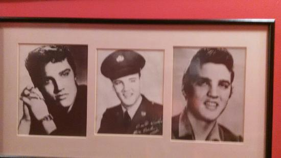 wall was covered with elvis picture of back yard bar