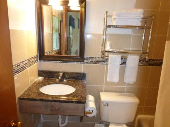 Skyline Motel: New sink, mirror and tile