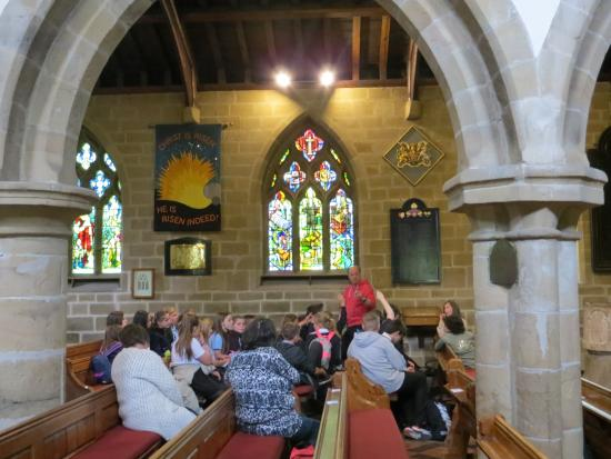Eyam Parish Church of St Lawrence: Stained galss window with pictorial history of plague