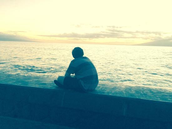 Kulakane: Sitting on the seawall watching the sun go down