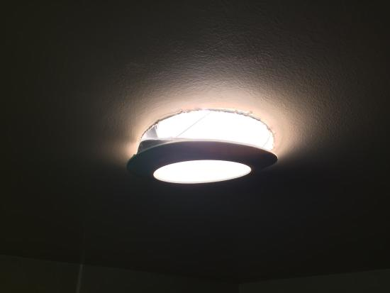 Wingate by Wyndham High Point: Light fixtures falling off,outlet not straight Thought Wyndham brand colors are green white and