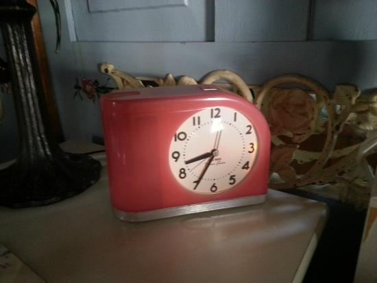 Pamela's Forget Me Not: The clock beside the bed was retro