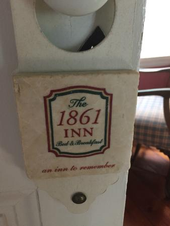 1861 Inn: Fun door hanger.